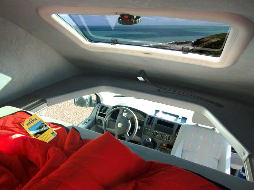 High-Top VW T5 with bed and front window installed - a cosy bedroom with a view!
